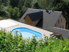 Sunbathing at the heated pool above the tops of Jizera mountains ...